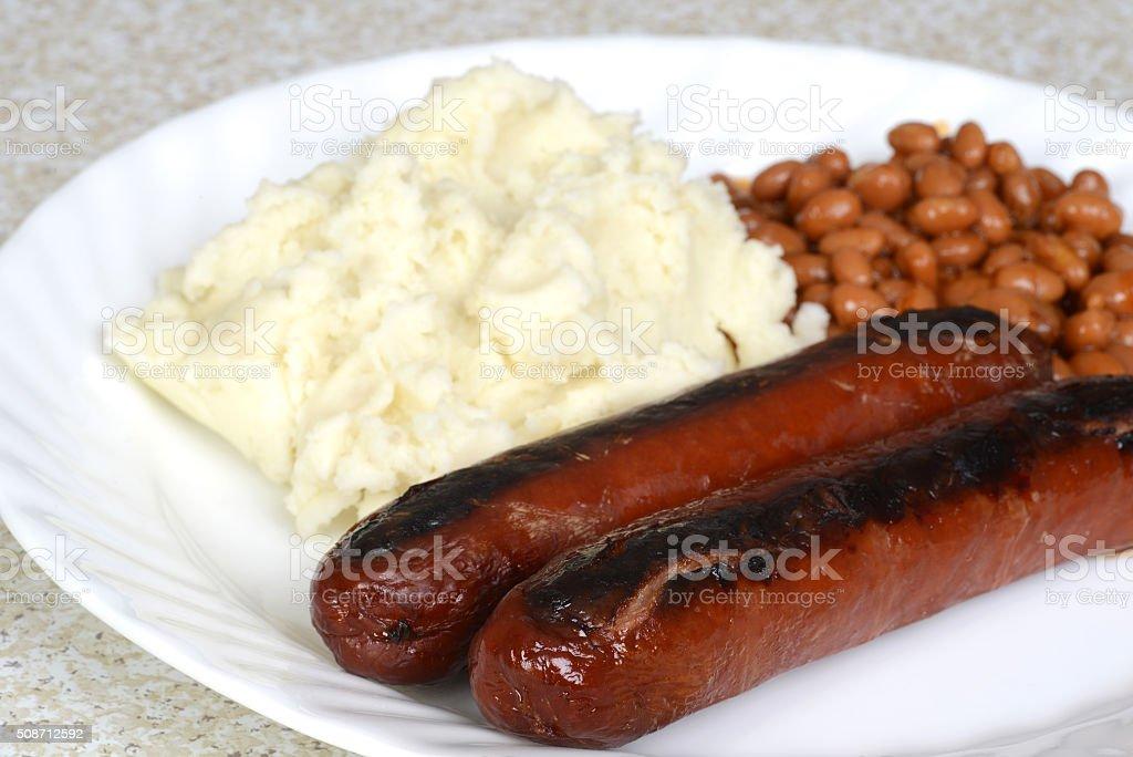 closeup sausages with mashed potatoes stock photo
