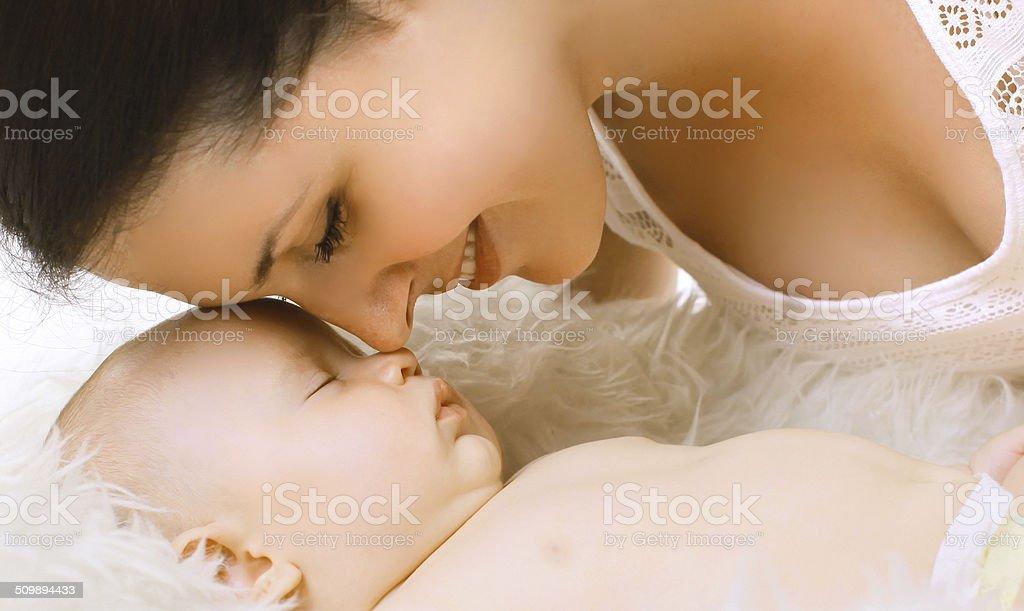 Closeup sensual tender mom and sleep baby stock photo