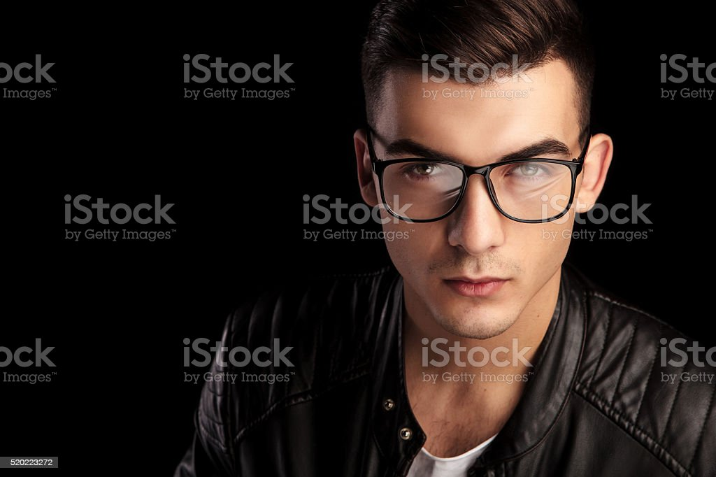closeup shaved macho in black leather wearing glasses stock photo