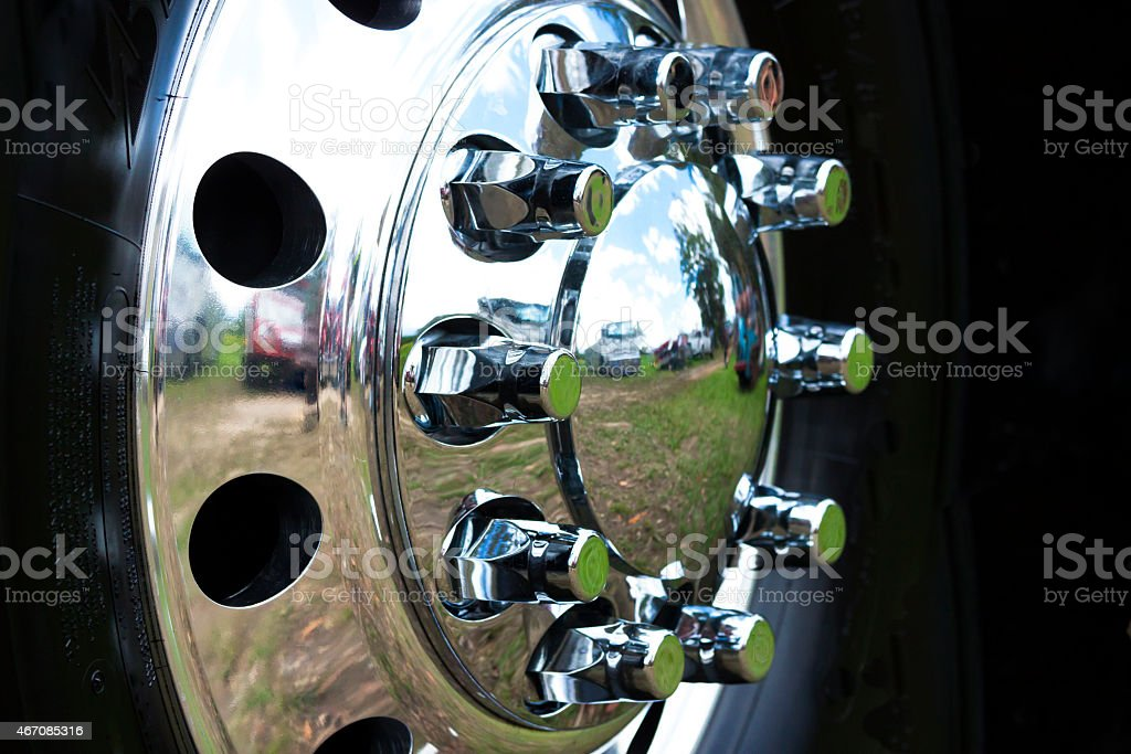 Closeup shiny truck hubcap stock photo