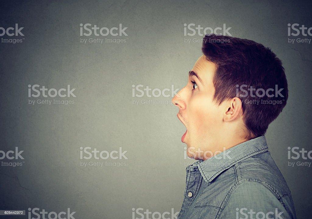 Closeup shocked dazed young man stock photo