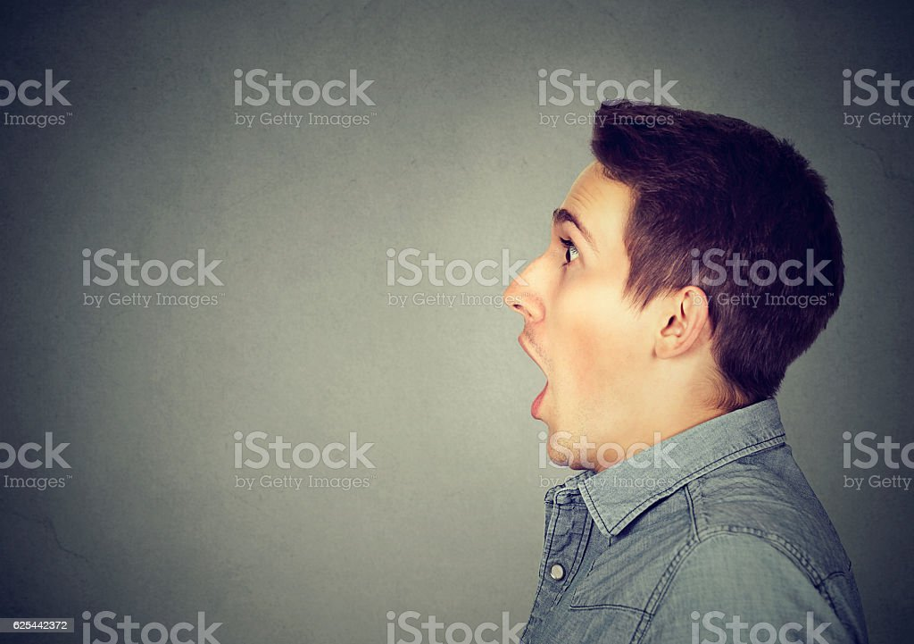 Closeup shocked dazed young man stock photo