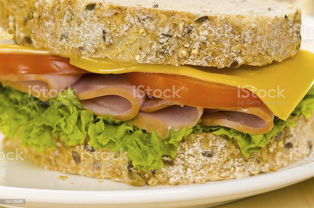 Close-up shoot of a Sandwich with rich Salad in simple royalty-free stock photo