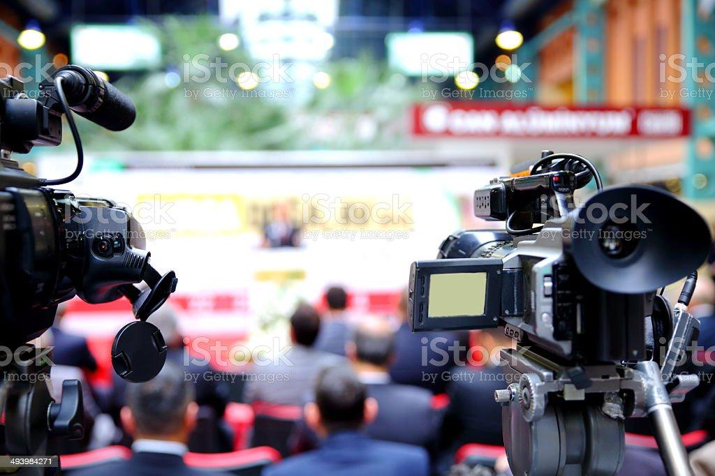 Close-up shot cameras at press conference stock photo