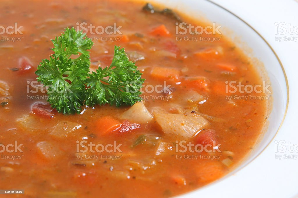 Closeup shot of a bowl of minestrone soup with garnish royalty-free stock photo