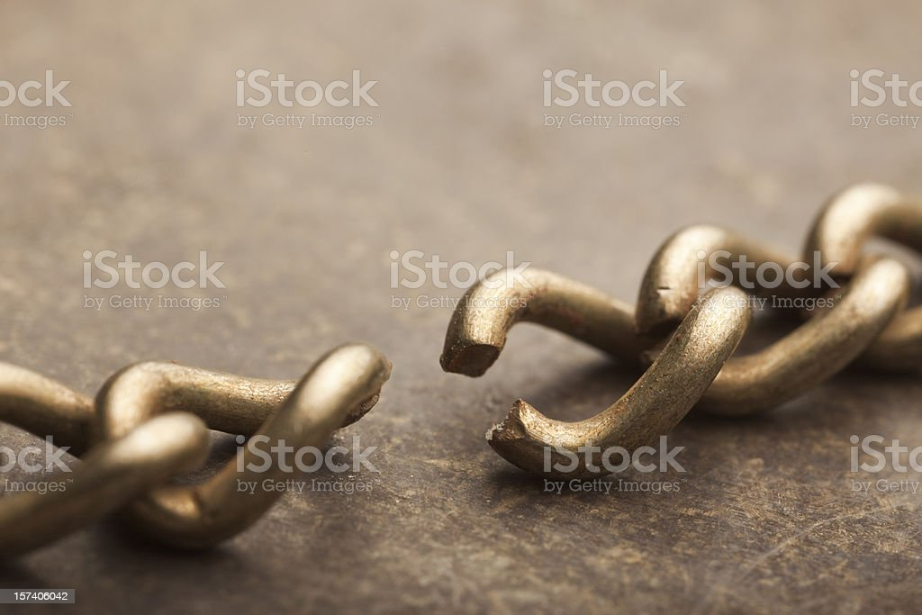 A close-up shot of a broken chain royalty-free stock photo