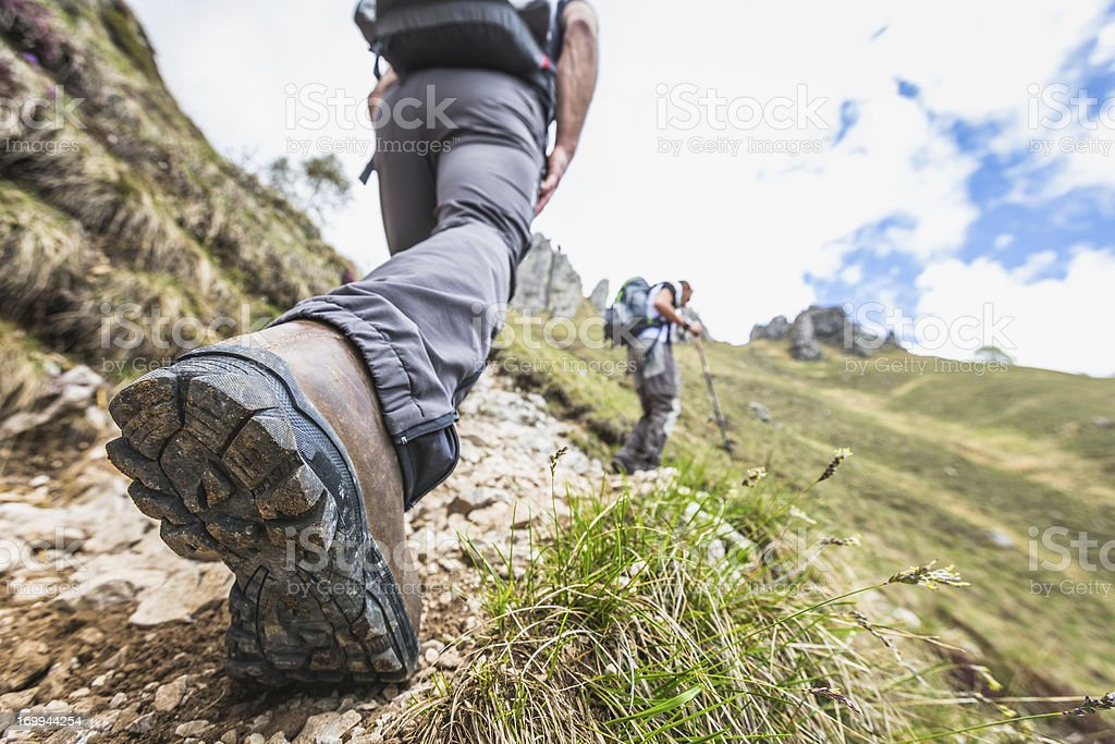 Closeup shot of a hiker's leg on mountain trail stock photo
