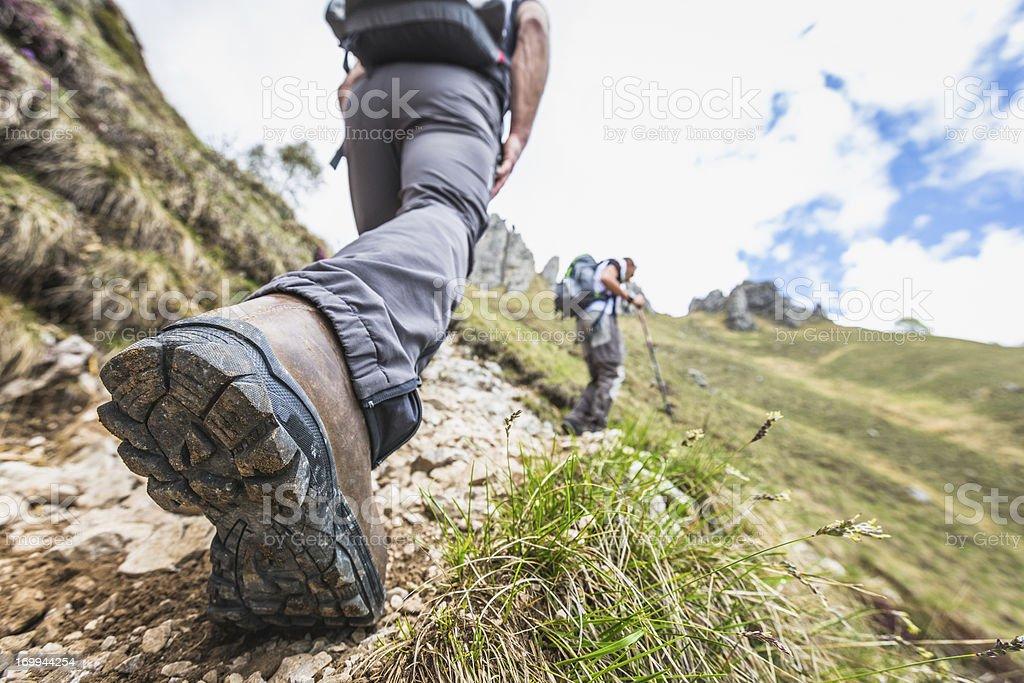 Closeup shot of a hiker's leg on mountain trail stock photo