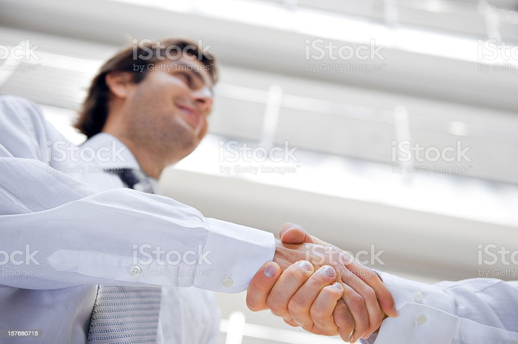 A close-up shot of a man shaking someone's hand royalty-free stock photo