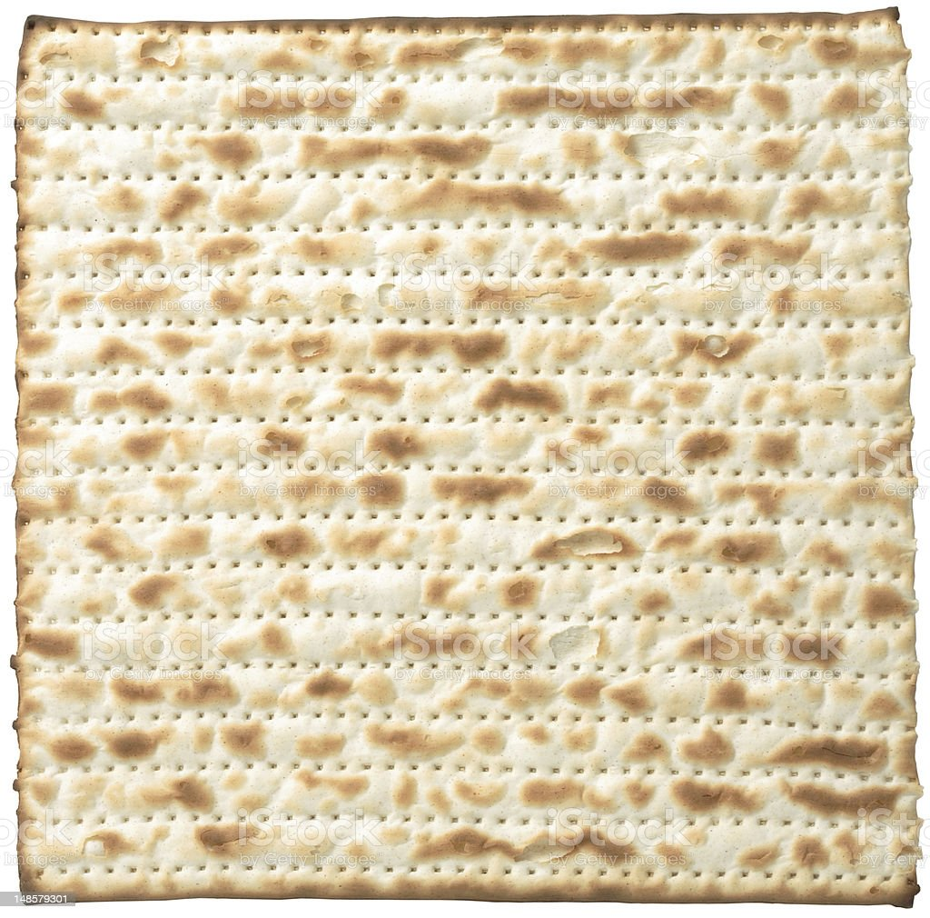 Close-up shot of a matzo isolated on a white background stock photo