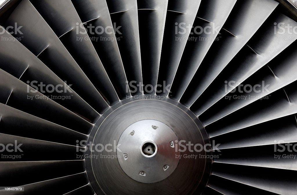A close-up shot of a sleek metal jet turbine stock photo
