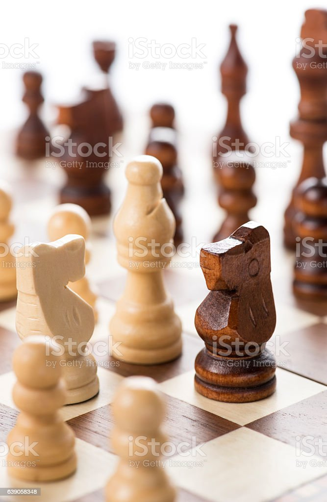 close-up shot of chess pieces on chessboard stock photo