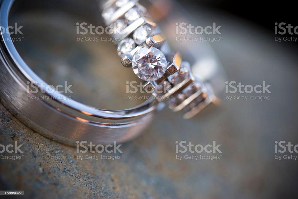 Close-up shot of diamond wedding ring and wedding band stock photo