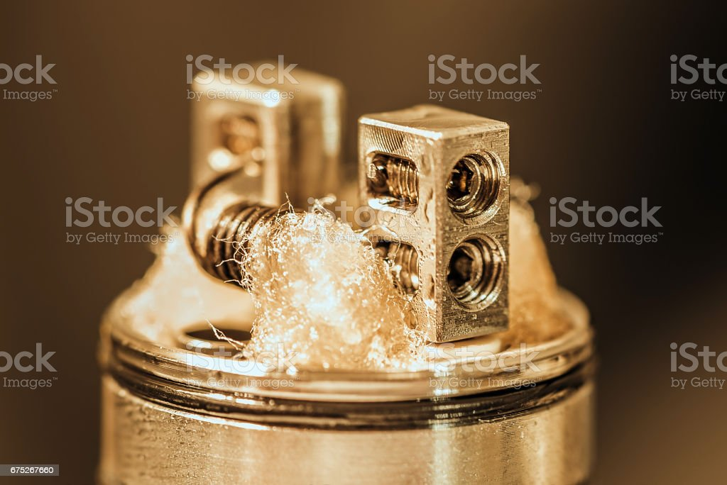 Closeup shot of dripping atomizer with coil build stock photo