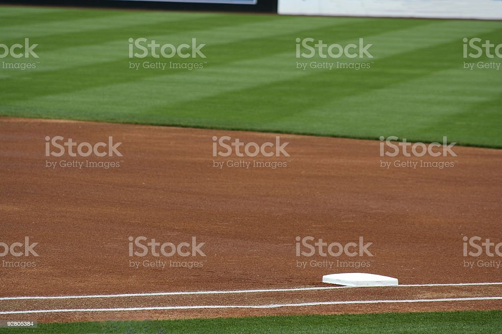A close-up shot of first base and the out field stock photo