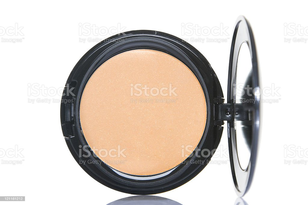 Close-up shot of foundation powder on white background stock photo