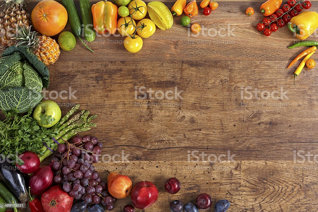 Closeup shot of fruits and vegetables on a table stock photo