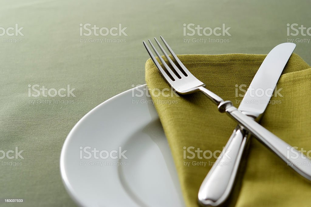 Close-up shot of green table setting with copy space royalty-free stock photo