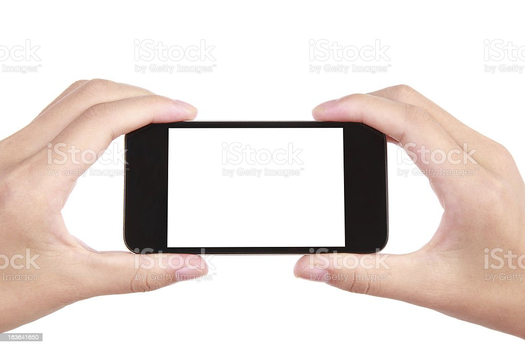 Closeup shot of hands holding mobile phone royalty-free stock photo