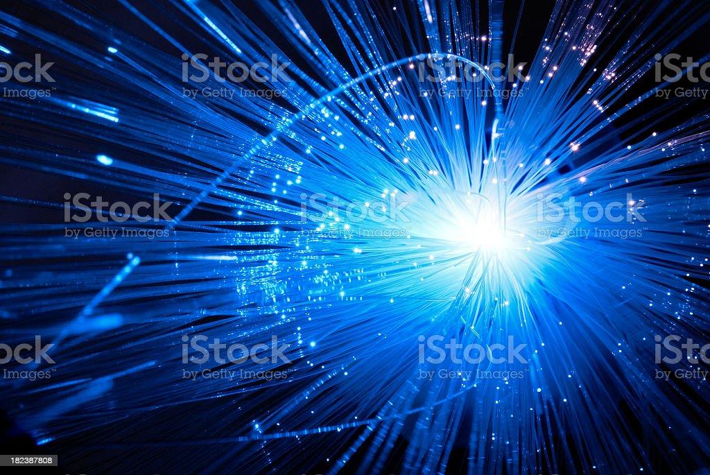 A closeup shot of lit up blue fiberglass threads stock photo
