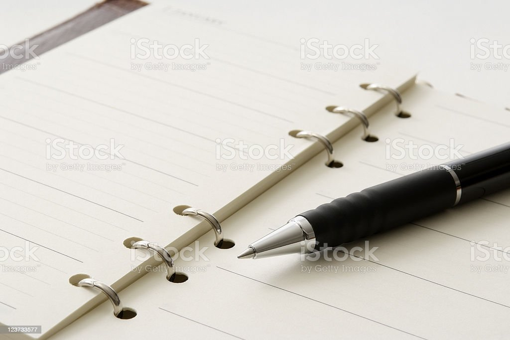 Close-up shot of opened personal organizer with pen royalty-free stock photo