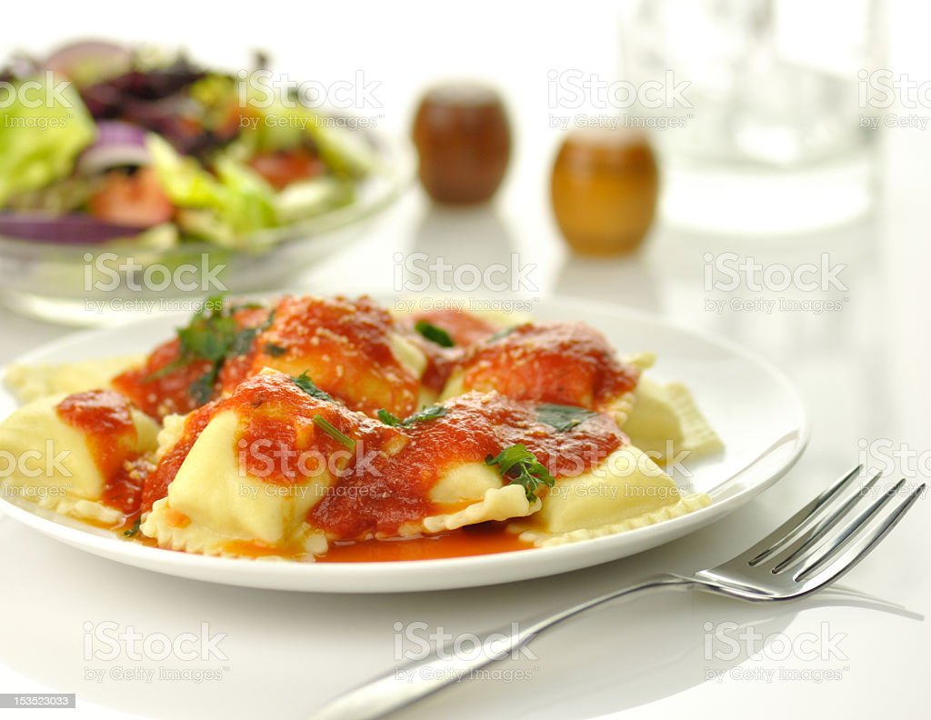 A close-up shot of pasta ravioli with red tomato sauce stock photo