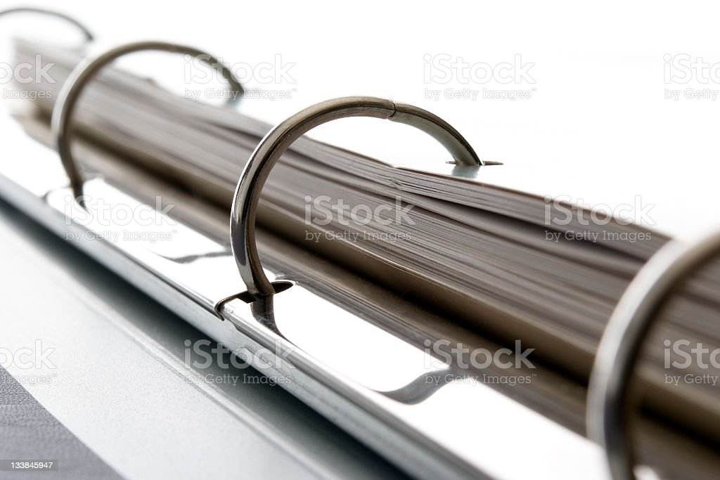 Close-up shot of ring binder against white background stock photo
