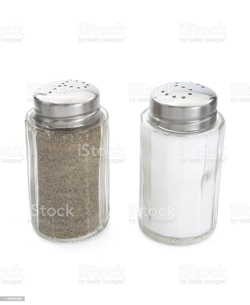 Close-up shot of salt and pepper seasonings stock photo