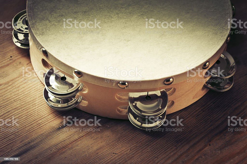 Close-up shot of tambourine on wooden floor stock photo