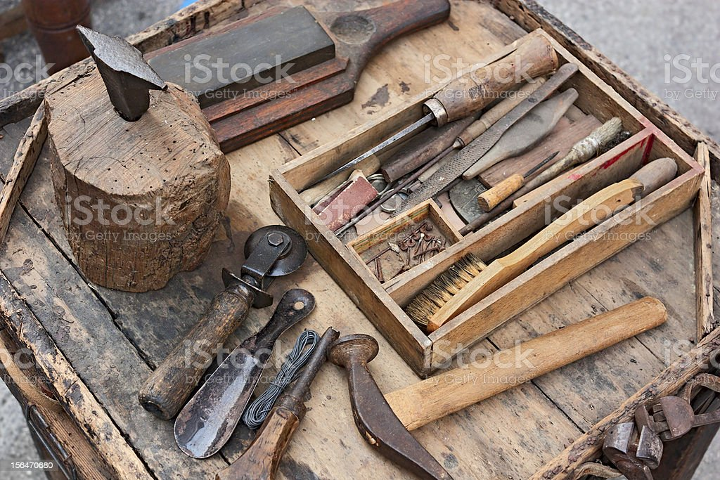 Close-up shot of the weathered tools of a shoemaker royalty-free stock photo