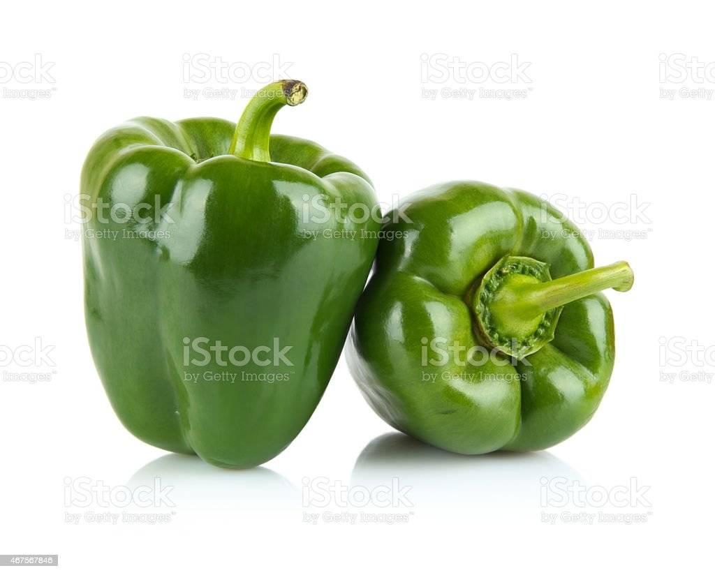 Close-up shot of two green bell peppers isolated on white stock photo