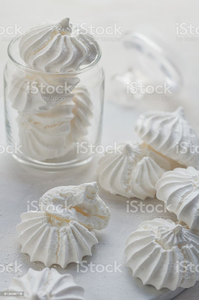 Close-up shot of white meringues on a white background stock photo