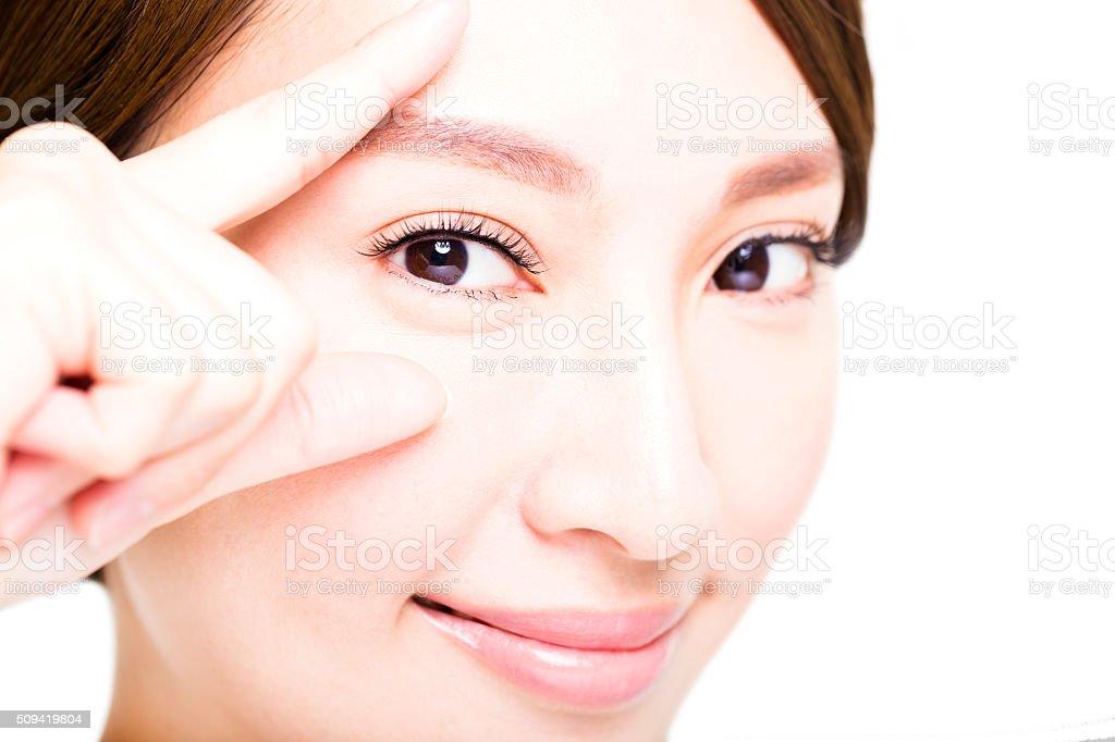 Closeup shot of young smiling woman eyes makeup stock photo