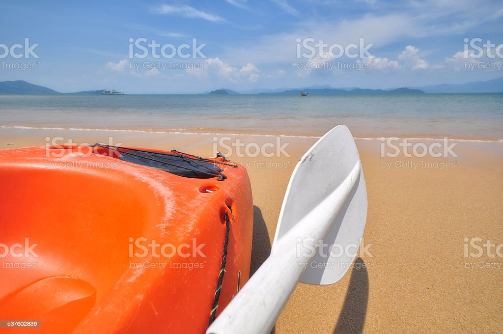 Close-up side of kayak boat with paddle on tropical beach stock photo