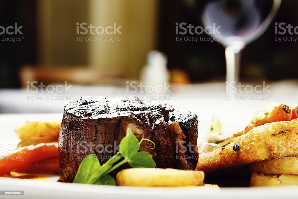 Close-up side view of delicious-looking grilled fillet  steak stock photo