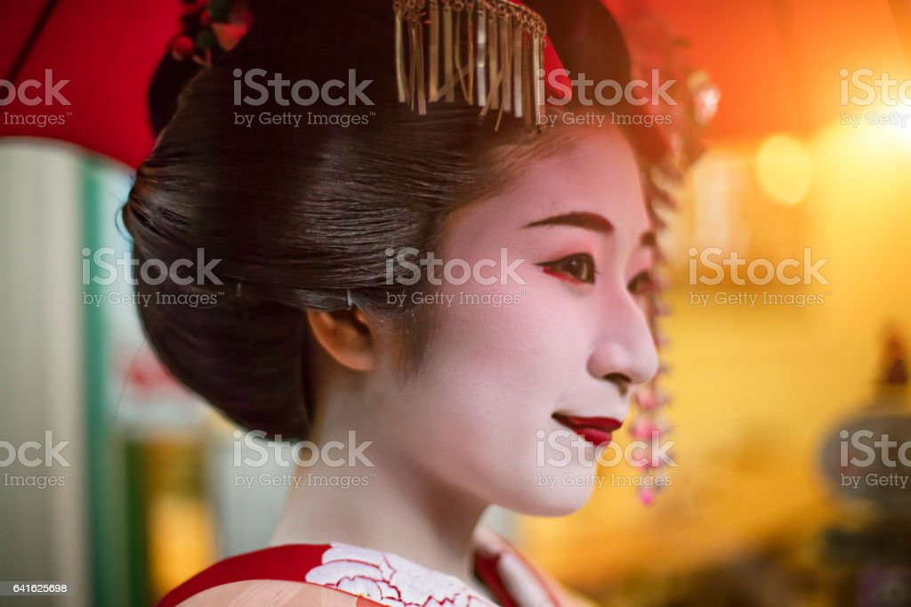 Close-up side view of thoughtful young geisha stock photo
