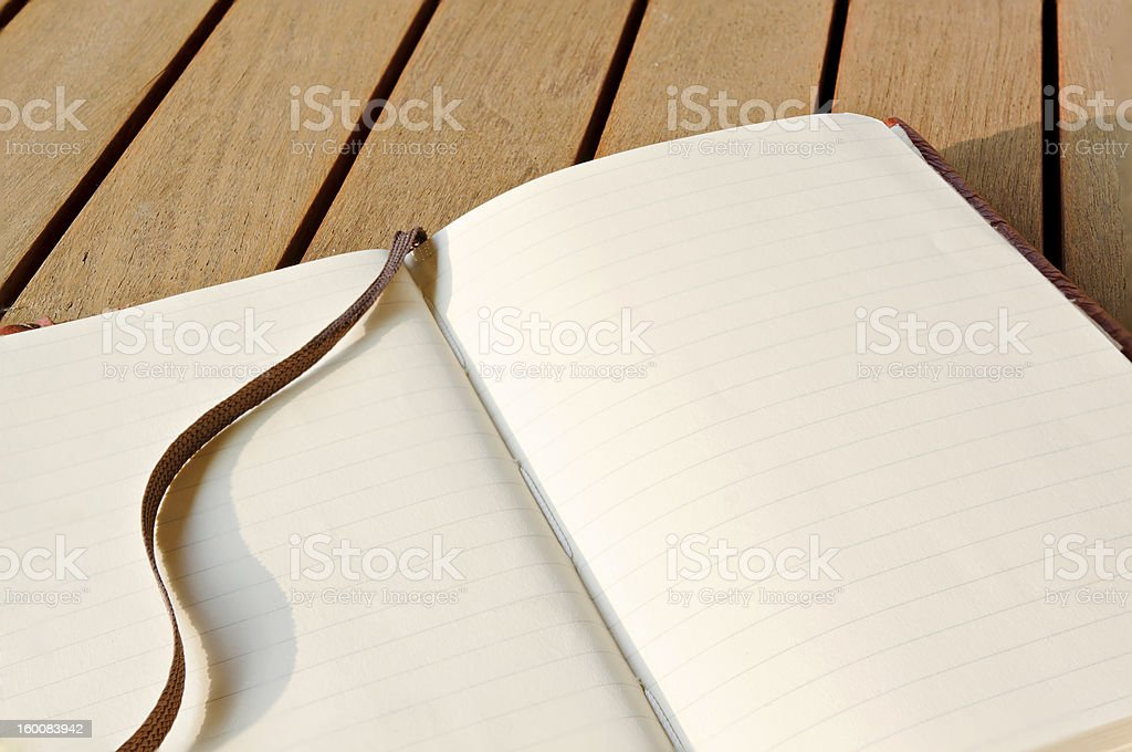 Closeup Sketchbook On A Wooden Table royalty-free stock photo
