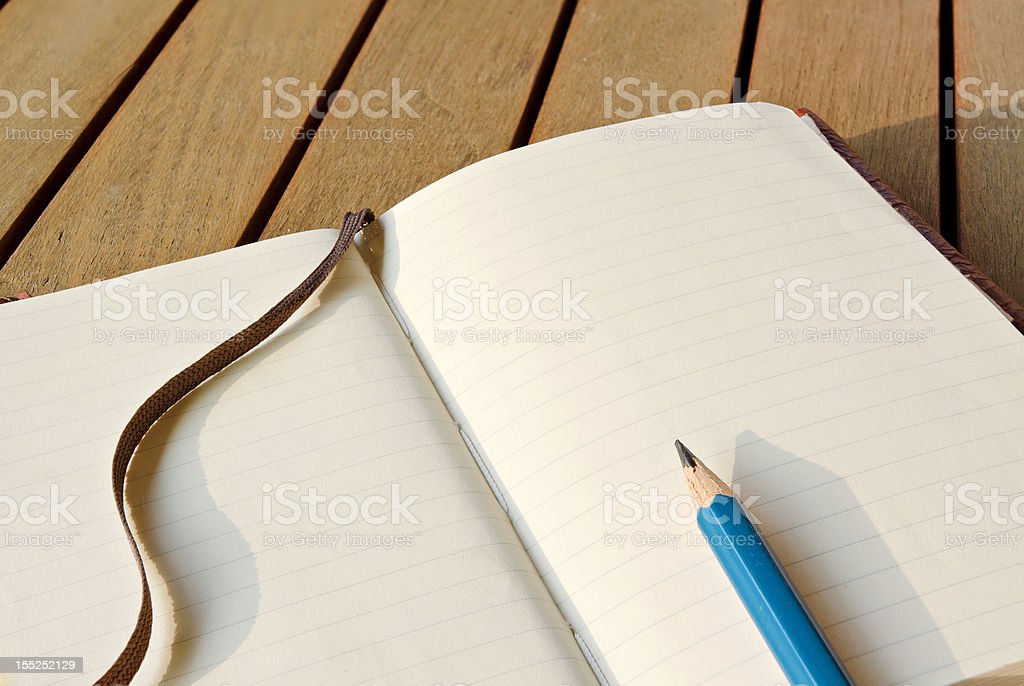 Closeup Sketchbook With Pencil On A Wooden Table royalty-free stock photo