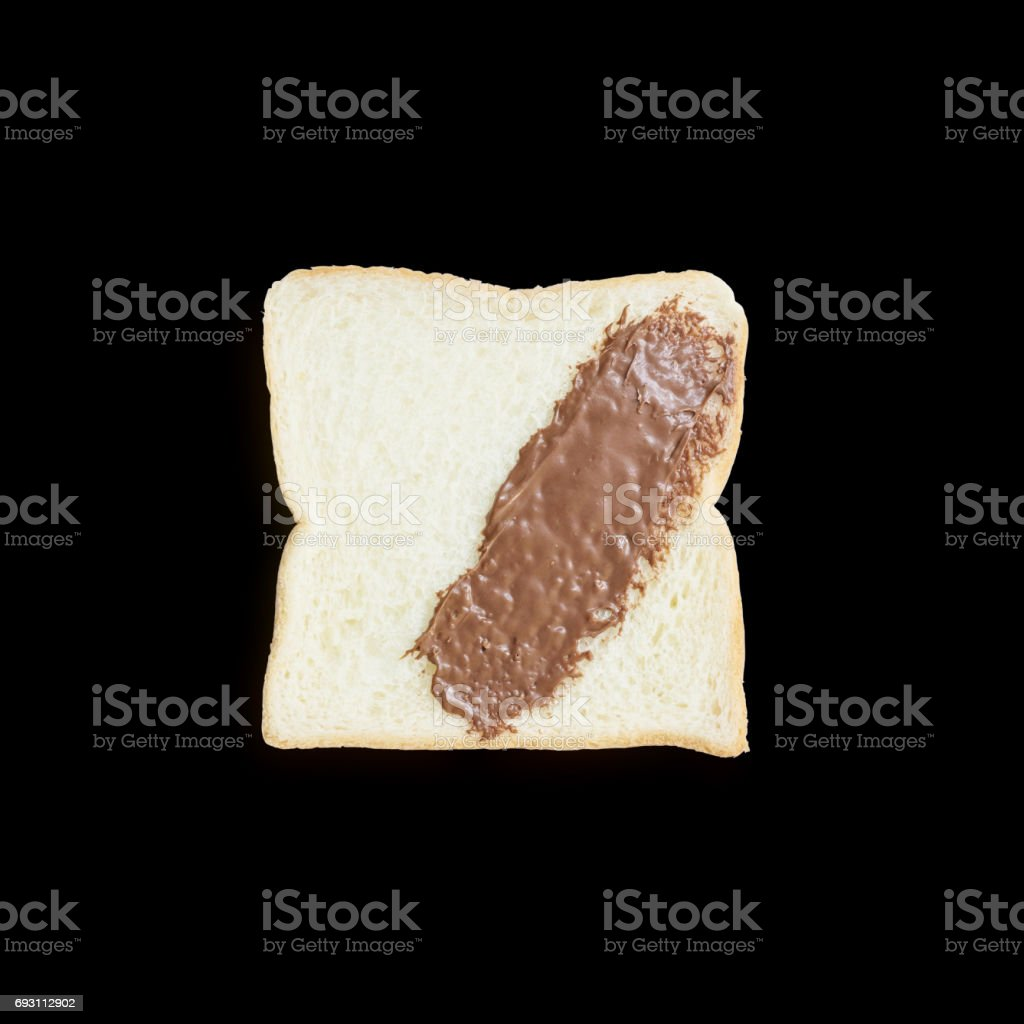 Closeup slice bread with chocolate for breakfast with shadow isolated on black background stock photo