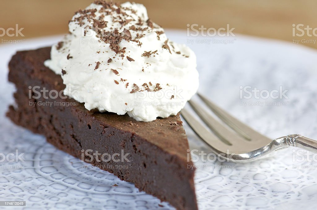 Close-up Slice of Chocolate Cake with Whipped Cream stock photo