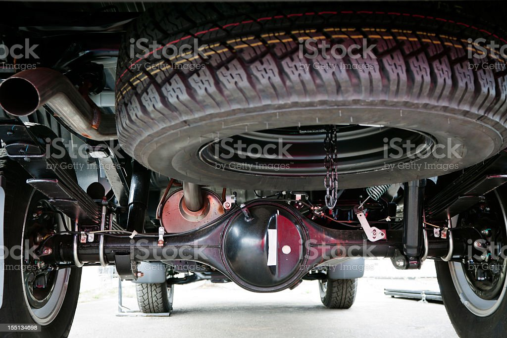 Closeup small truck spare tyre attached under the vehicle stock photo