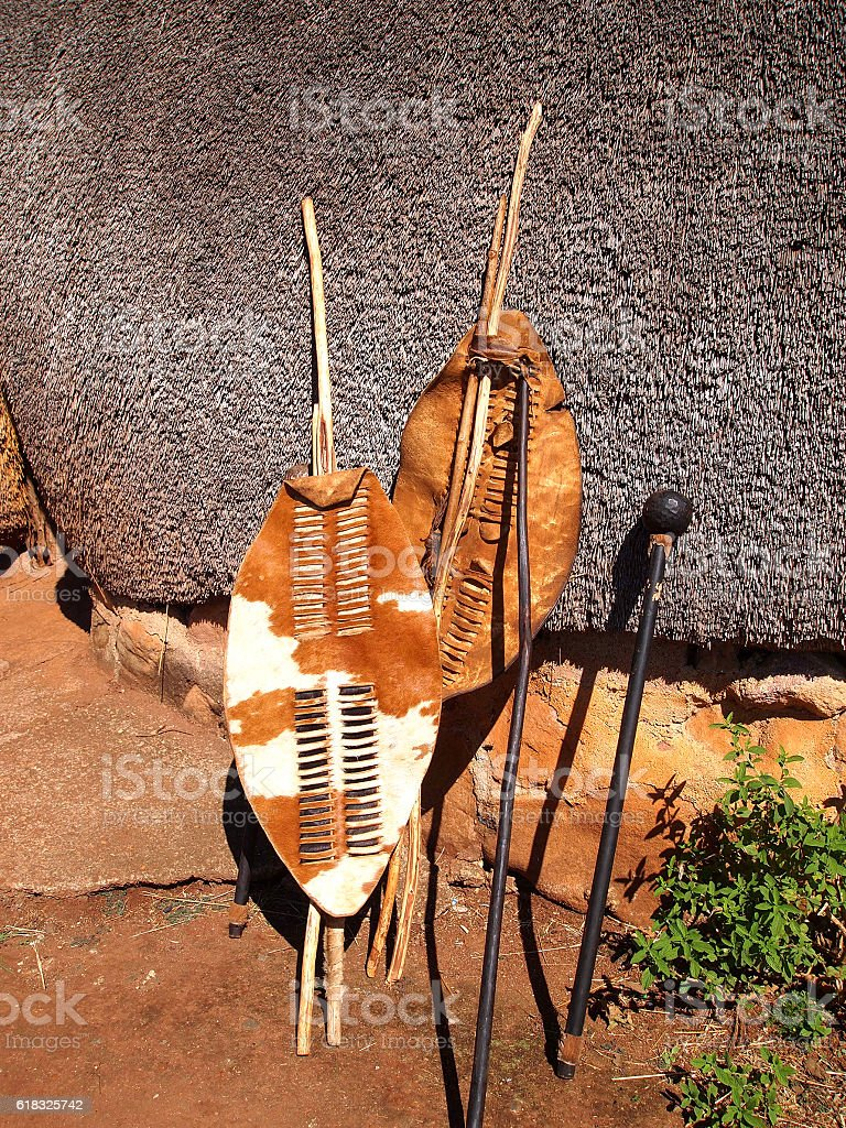 Close-up South African Zulu spears, warrior shields and assegai. stock photo