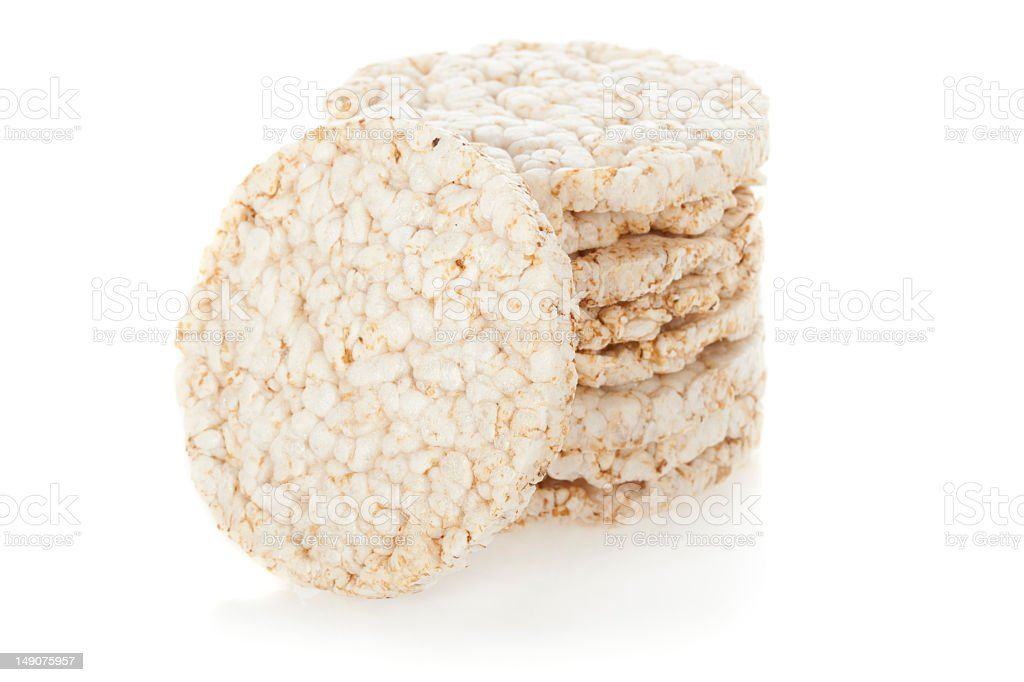Close-up stack of diet rice cakes on white background stock photo