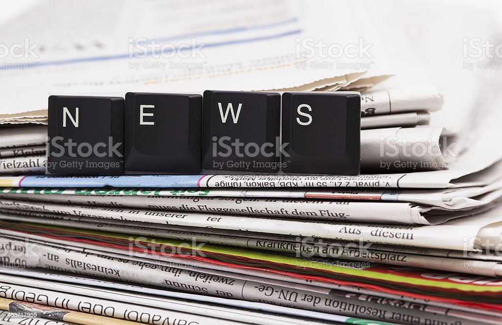 Closeup stack of newspapers stock photo