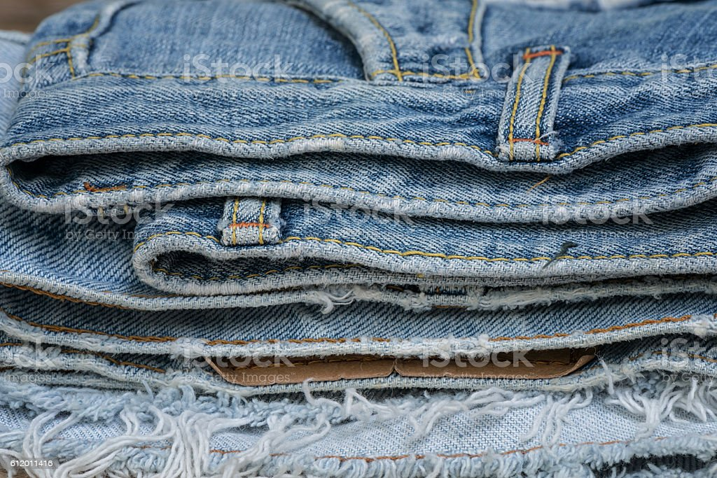 Closeup stack of old jean stock photo