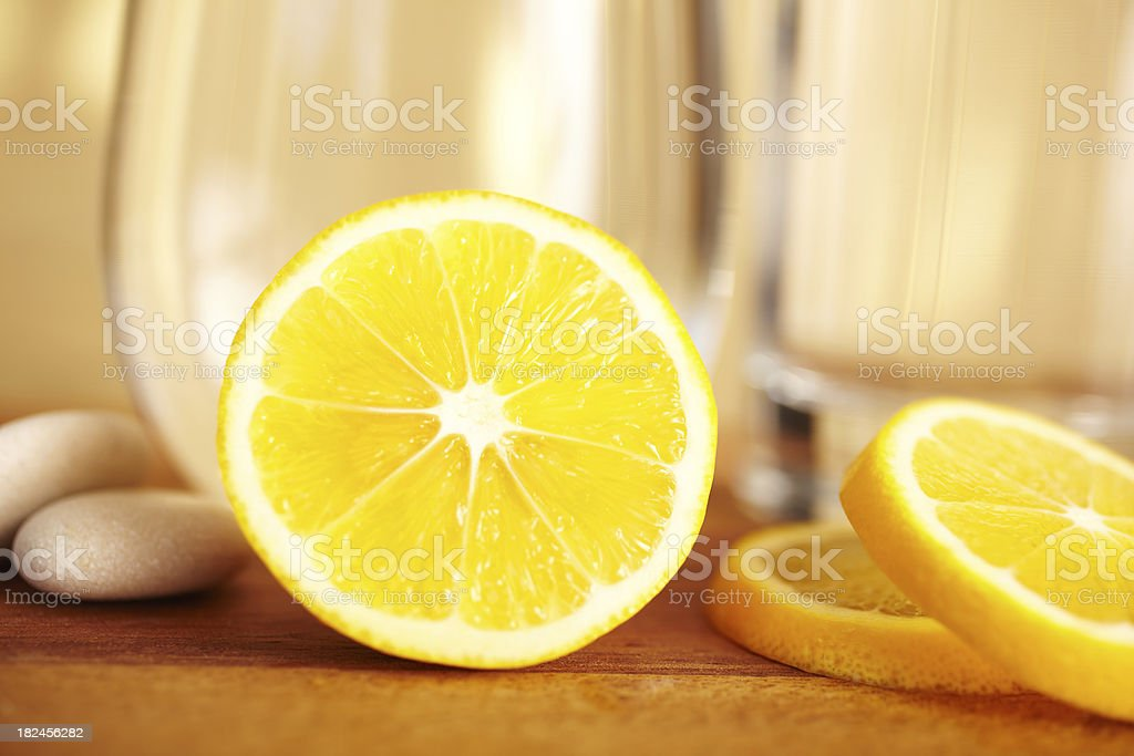 Close-up still life of a meyer lemon with water royalty-free stock photo