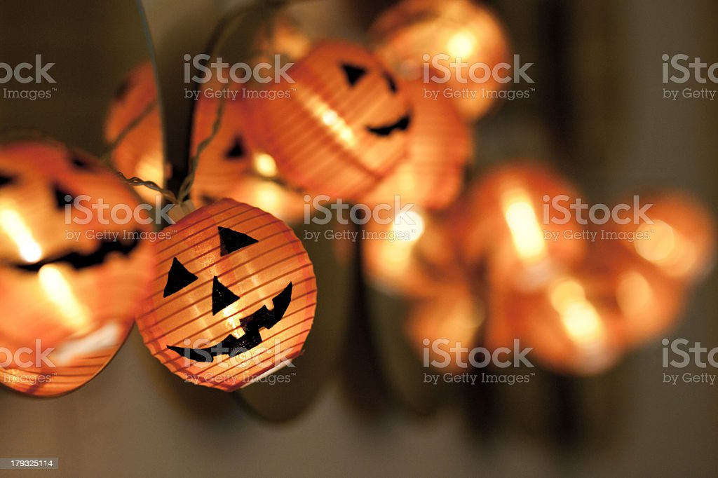 Close-up string of pumpkin lights moving out of focus stock photo