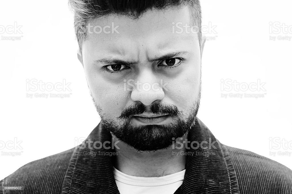 Close-Up Studio Portrait Man Doubt Facial Expression on white stock photo