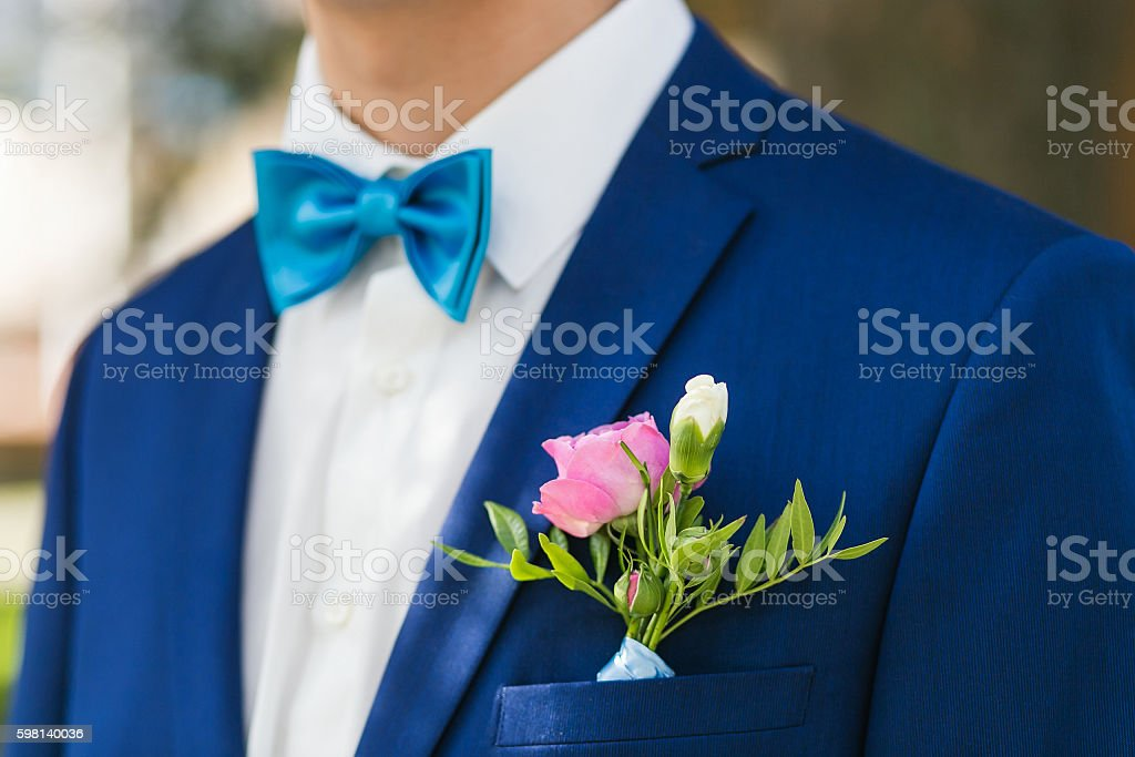 Closeup stylish groom clothed in blue jacket and white shirt stock photo