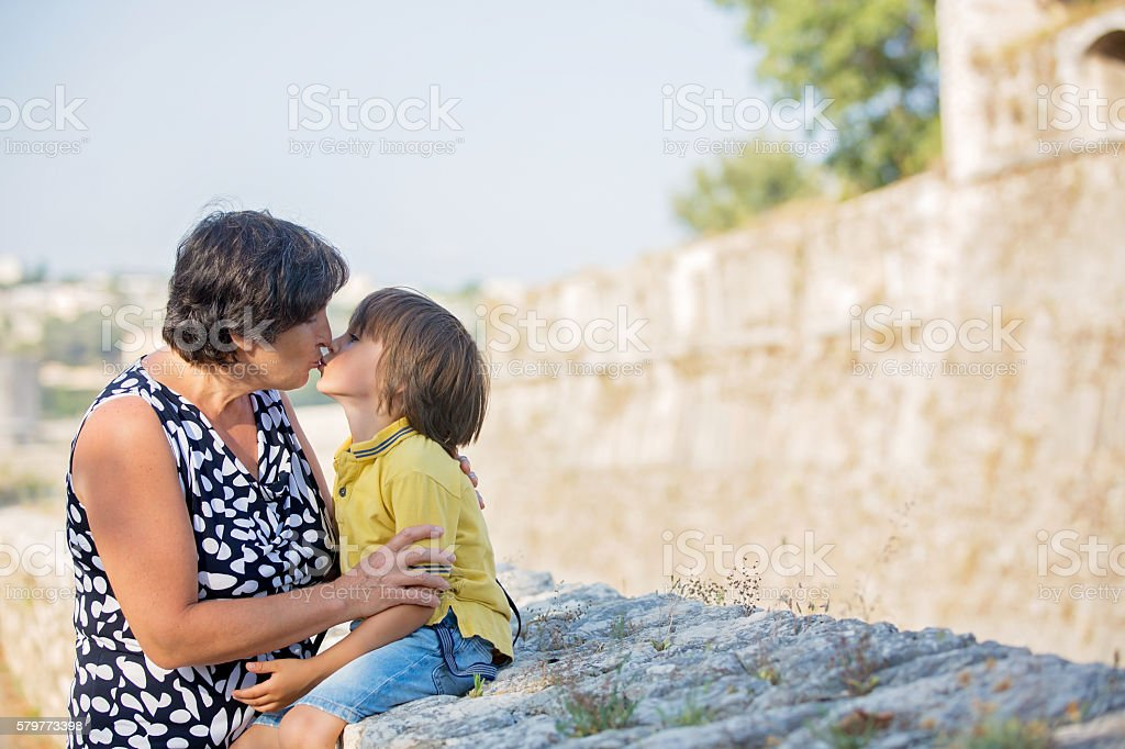 Closeup summer portrait of happy grandmother with grandson stock photo